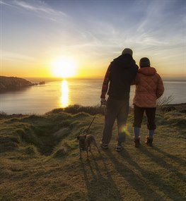 Couple walking on the Isle of Wight clifftops