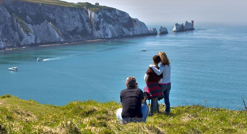 The Needles Landmark - family overlooking needles