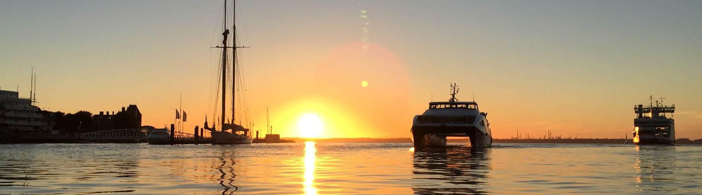 Sunset with Vehicle Ferry and Red Jet