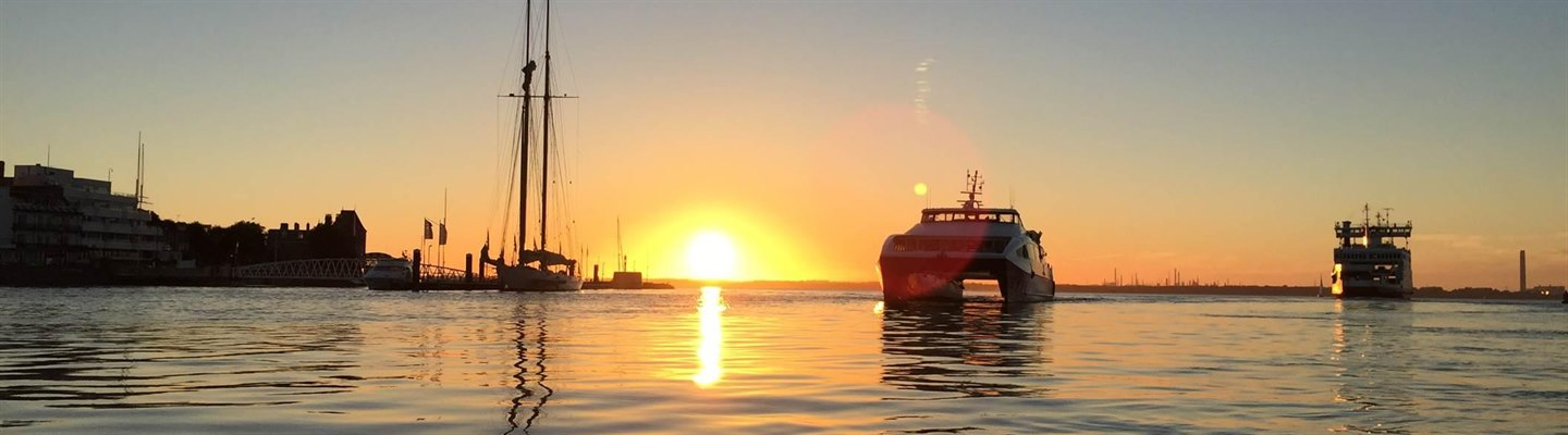 Red Jet and Vehicle Ferry Sunset in Cowes