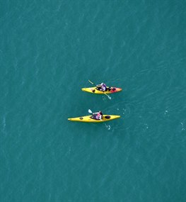 Two people kayaking off the Isle of Wight