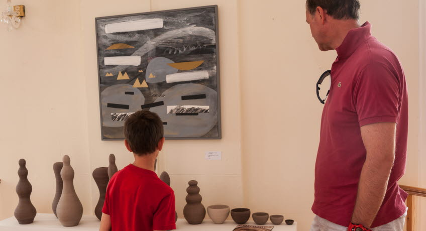 Father and son viewing arts and crafts Isle of Wight Arts Open Studios